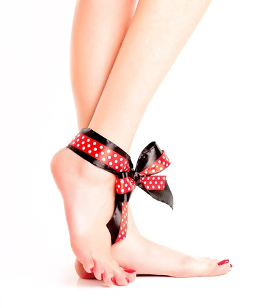 Legs with a bow on white background photo