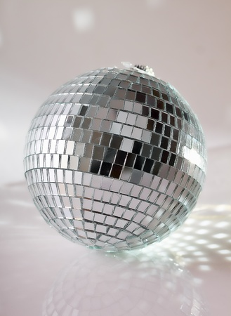 Disco ball on grey background photo
