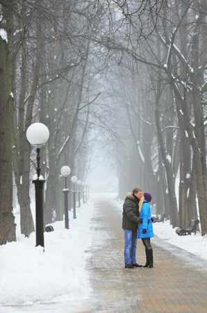couple winter: Young adult couple in the park. Winter. Stock Photo