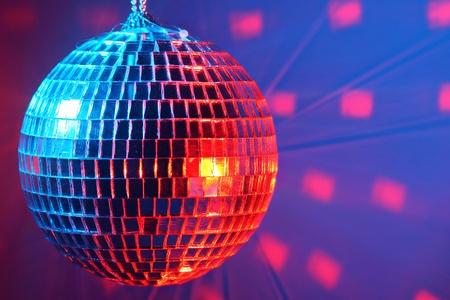 Disco ball on dark background photo