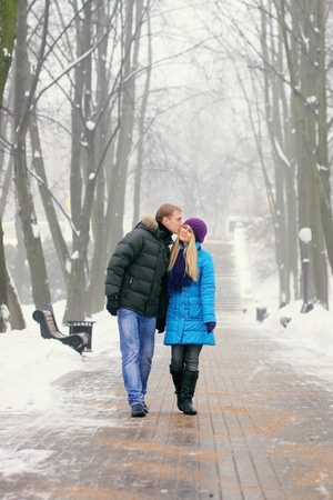 Young adult couple in the park. Winter. Stock Photo
