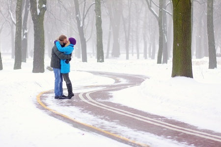 Young adult couple in the park. Winter. Stock fotó