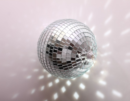glowing ball: Disco ball on grey background Stock Photo