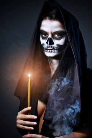 Gothic portrait of dead woman with candle photo