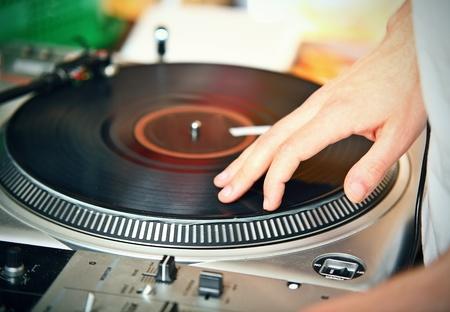 DJs hand spinning vinyl record photo