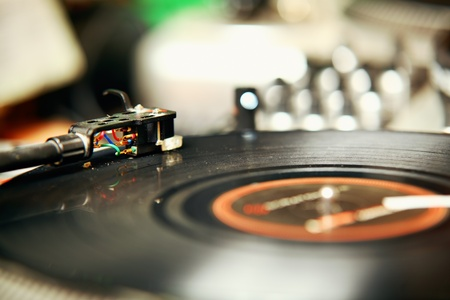 Record player spinning the disc with music Stock Photo