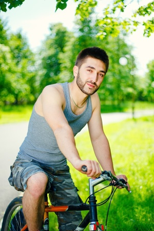 Young man cyclist sitting on bicycle photo