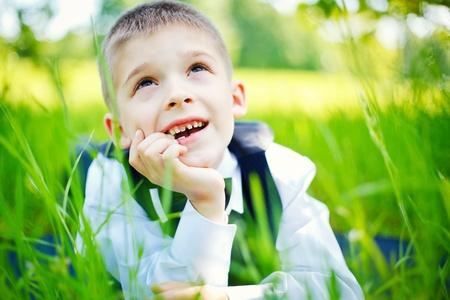 Little boy in green grass photo