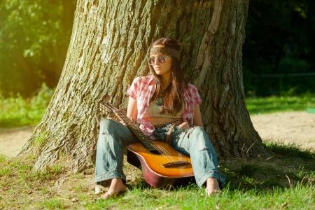 Beautiful hippie girl with guitar photo