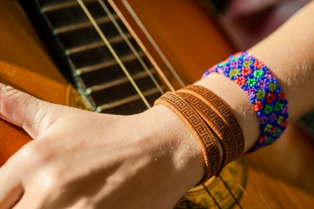 Hand hippie girl with guitar photo