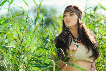 Beautiful hippie girl posing outdoor  photo