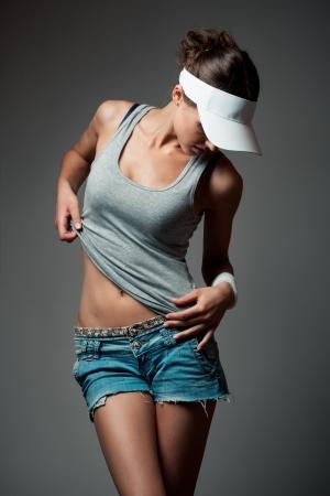 the shots: Young woman in sports clothing  Studio shot
