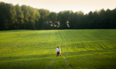 Young couple in love outdoor. Tilt-shift lens. photo