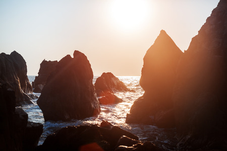 Sunlight shining on the rocks Stock Photo