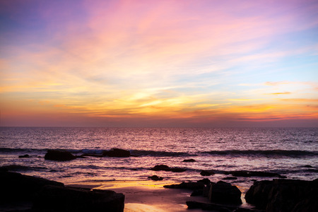 rocky coastline: Majestic sunset over water. India, Goa. Stock Photo