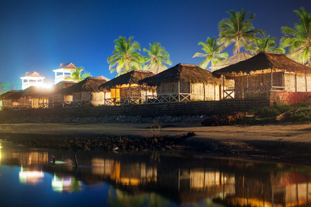 bungalows: Night landscape - bungalows near water