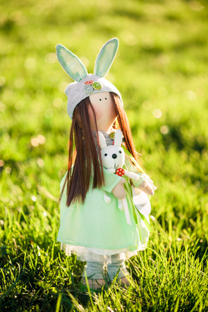 editorial: Funny dolls on green grass