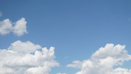 Blue sky with a clouds in a clear summer day background