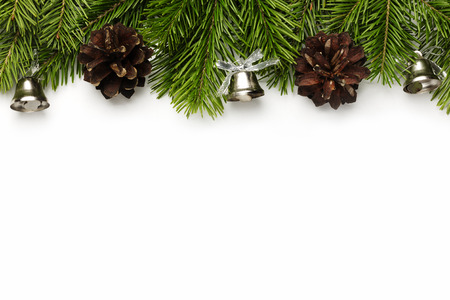 silver bells: ChristmasNew Year tree branches with silver bells and cones isolated on white
