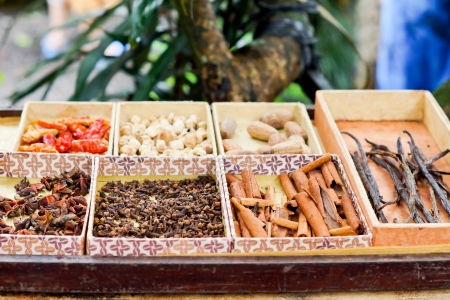 christmas scent: Trays of dried spaces and herbs for sale on a market stall including bark cinnamon, chillies and vanilla pods