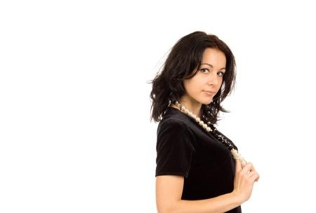 Hermosa mujer sexy posando de lado mirando a la c�mara con una mirada seductora, retrato en blanco