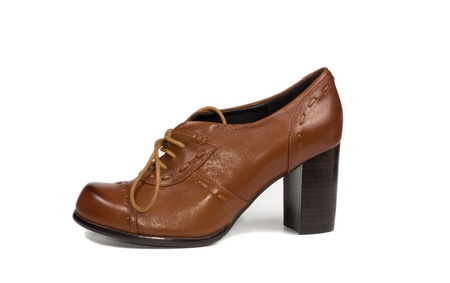 Elegant classical brown leather ladies court shoe with a stacked high heel and laces for everyday wear on a white studio background Stock Photo - 17305401