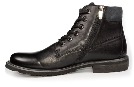 Classical black leather mans ankle high laceup boot for everyday formal wear on a white studio background photo