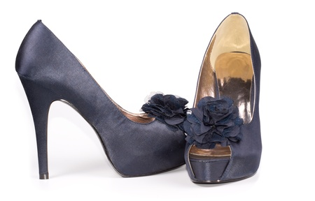 open toe: Side and front view of a pair of stylish blue leather ladies shoes with flower decoration on the open toe and stiletto heels on white