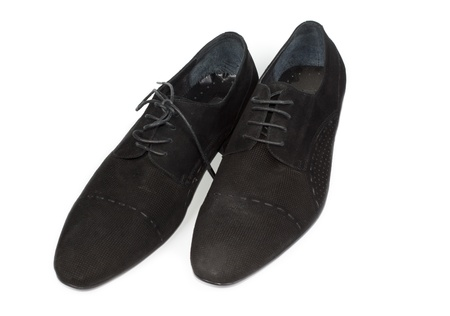 Pair of ladies low heeled black lace up shoes for everyday comfort and casual wear on a white background photo