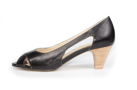 Side view of a womans open toed black leather court shoe with cut away sides and a medium height stacked heel on a white background Stock Photo - 17420072
