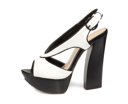 heel strap: Side view of a stylish modern womans white leather platform sandal with a high heel and buckled strap on a white background