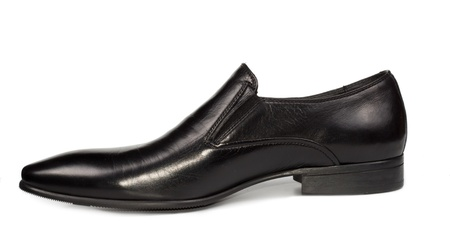 Elegant black leather mens slip on shoe with a high tongue and low heel for smart casual wear on white photo