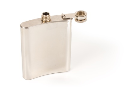 concave: Concave traditional silver metallic hip flask for carrying a nip of brandy or spirits in your pocket isolated on white with copyspace