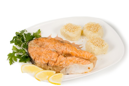 Delicious grilled salmon steaksreved with soft bread rolls and sliced lemon photo
