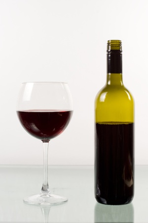botle: Bottle and glass of red wine on white background