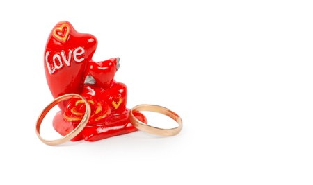 inscribed: Two gold rings with a token of love in the form or a red ornament inscribed with the word Love