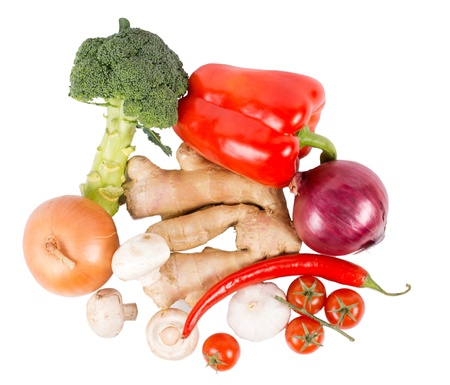 Assortment of organic fresh vegetables and spices including broccoli, onion, chilli pepper, bell pepper, ginger, mushrooms and cherry tomatoes isolated on white, high angle Stock Photo - 18523658