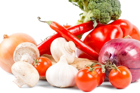 Healthy organic vegetables, tomatoes, mushrooms, onion, red pepper, broccoli, on white background Stock Photo - 18523743
