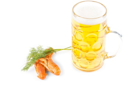 Lunchtime snack of a tankard of golden beer and fresh cooked prawns with a sprig of fresh dill photo