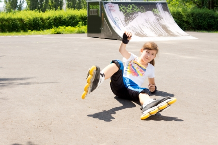 rollerskater: Young girl takes a fall whilst practicing rollerblading stunts Stock Photo