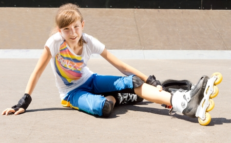 rollerskater: Young happy blond girl enjoying outdoor workout with skates Stock Photo