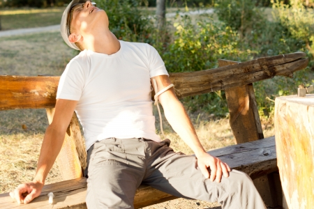 intravenously: Middle-aged Caucasian man experiencing hallucinations after a drug dose administered intravenously on a bench in the park