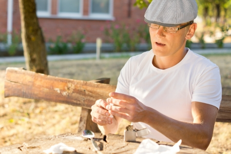 intravenously: Addicted man preparing the next dose of heroin in order to inject it intravenously Stock Photo