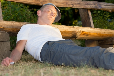 passed out: Unconscious heroin user passed out on the ground after an overdose Stock Photo