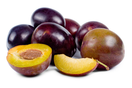 laxative: Delicious collection of fresh whole and sliced plums for a healthy dessert, often enjoyed for their laxative properties, on white Stock Photo