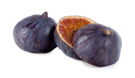 purple fig: Whole and sliced fresh purple fig showing the texture of succulent sweet pips, healthy snack and cooking ingredient Stock Photo