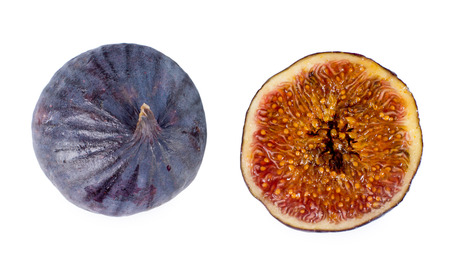 purple fig: View from above of a whole and halved fresh juicy ripe purple fig showing the stalk and red sweet seeds isolated on white Stock Photo