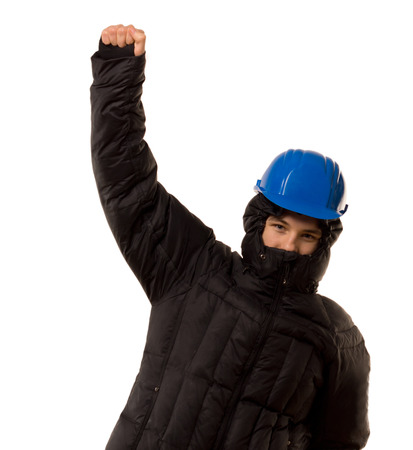 malevolent: Young teenage thug in a black hoodie and hardhat punching the air with his fist in a sign of aggression and victory, isolated on white Stock Photo