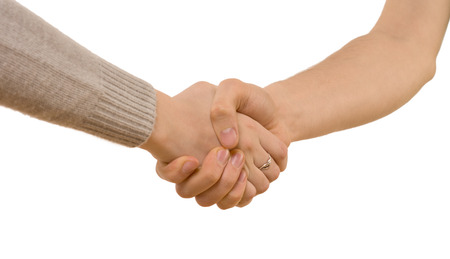 Handshake between a young man and woman wearing a long sleeve jersey as they clasp hands tightly, close up view isolated on white photo