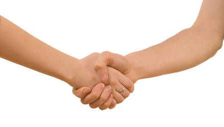 clasping: Young man and woman with bare arms shaking hands clasping each other tightly, closeup view of the handshake isolated on white